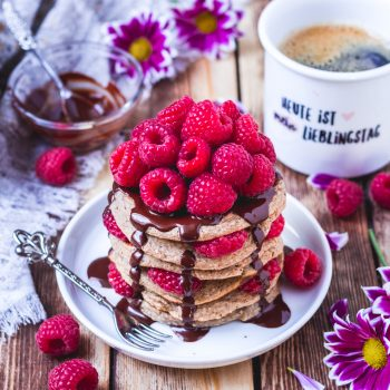 vegan protein pancakes with raspberries and chocolate