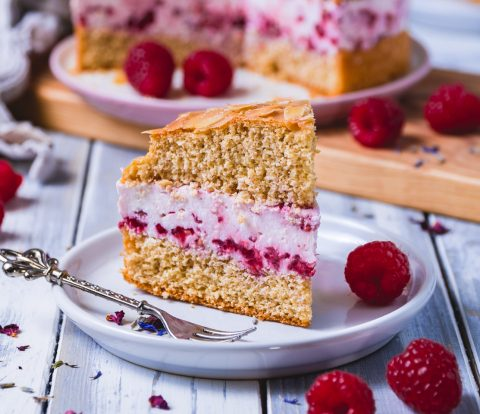 healthy bee sting cake with raspberries and cream